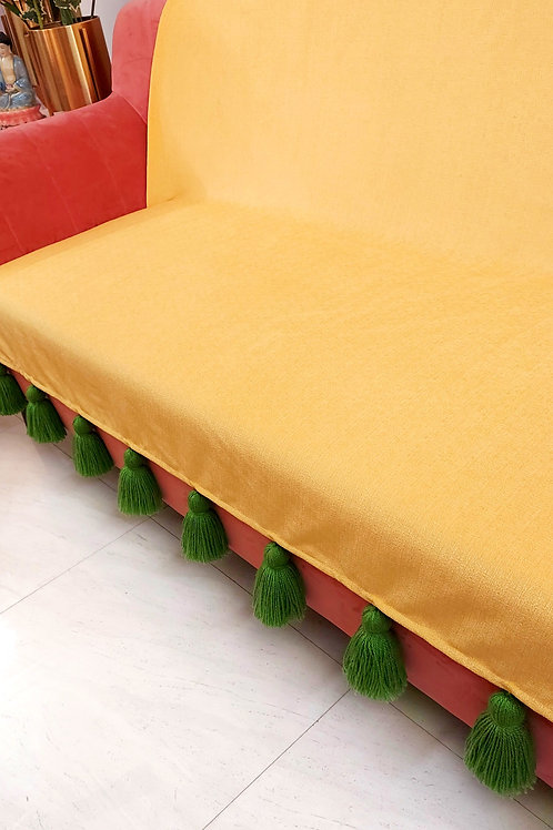 Yellow solid throw/couch cover with green tassels