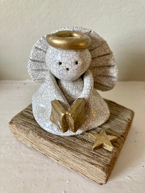 Mounted Angel with book