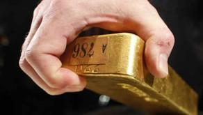 Ouro atinge a baixa em 1 mês