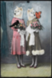 artwork - two ladies in 1920's dress posing for studio photograph, over their faces is painted white wolf heads and also feature a black hawk and butterfly with both ladies holding posies of flowers