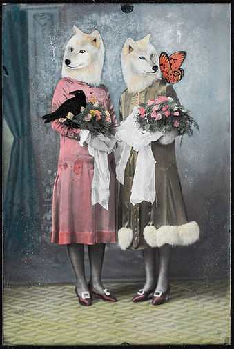 artwork - vintage photo and acrylic - two ladies in 1920's dress posing for studio photograph, over their faces is painted white wolf heads and also feature a black hawk and butterfly with both ladies holding posies of flowers