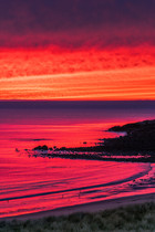 Sky on fire above the Minch and the Western Isles from Opinan Beach, Wester Ross.