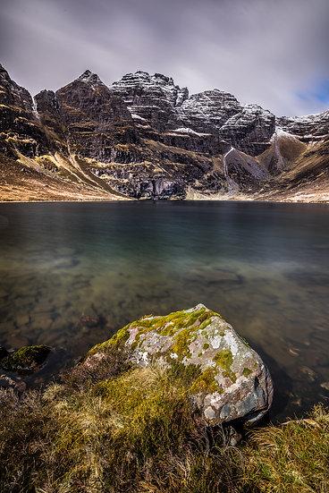 The jagged An Teallach dropping down into emerald Loch Toll an Lochain