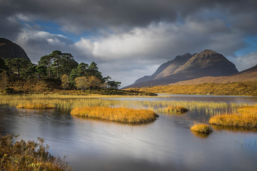 Autumn colours on Loch Clair with Liathach in the distance.