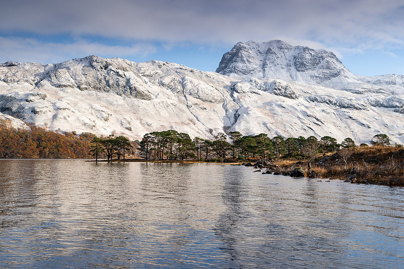 Clouds clearing a snow covered Slioch