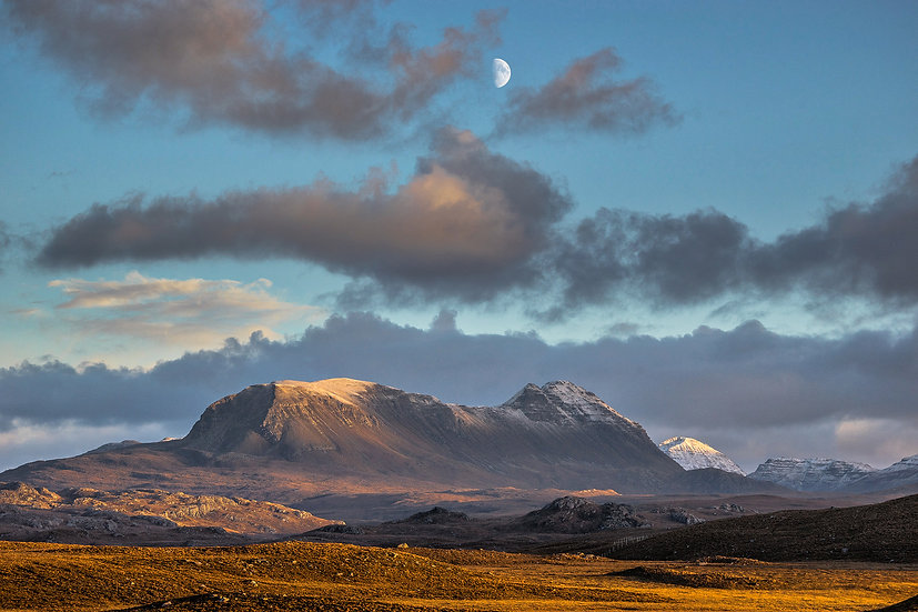 Moon over an Autumnal Baosbheinn in the late afternoon light.
