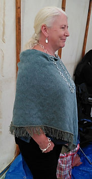 Seashore merino textured poncho knitted by Elizabeth Larsen Knitwear. Knitwear designed and made in Scotland.