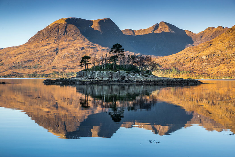 Small island relecting in upper Loch Torridon