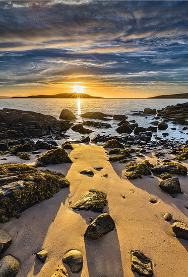 Sun setting over Longa Island from Big Sand.