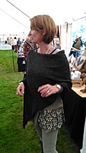 Highland poncho knitted by Elizabeth Larsen Knitwear. Knitwear made in Scotland.