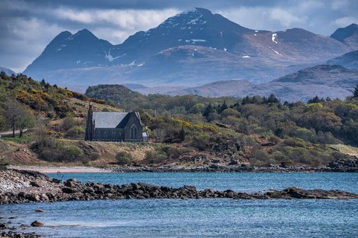 Looking towards the Free Church of Scotland, Gairloch with Beinn Alligin in the background.