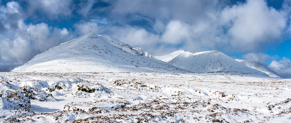 Clouds clearing An Teallach after heavy snow showers.