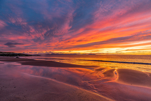 Dramatic skies over the Minch after sunset on Opinan Beach, Wester Ross.