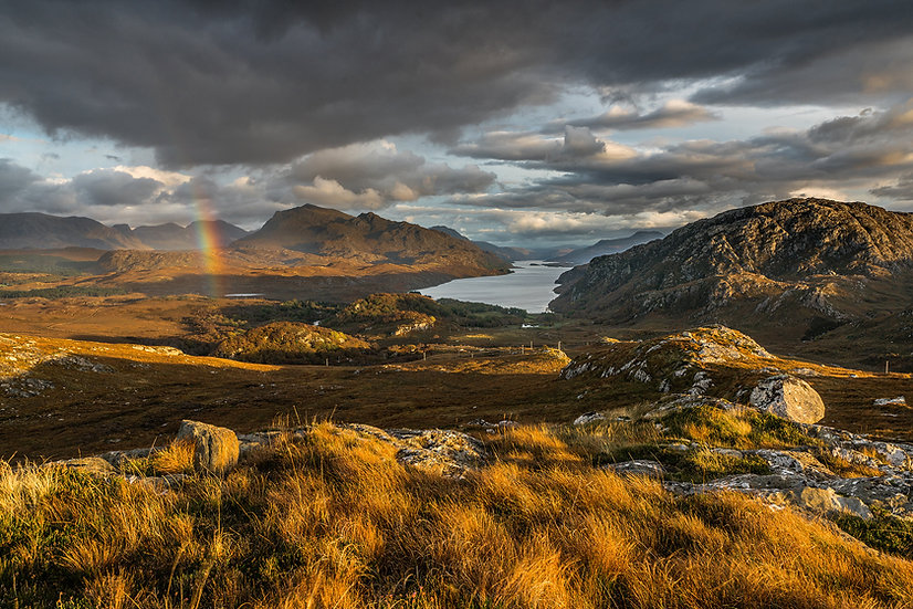 Slight rainbow over the Fishfield mountains and Beinn Airigh Charr.