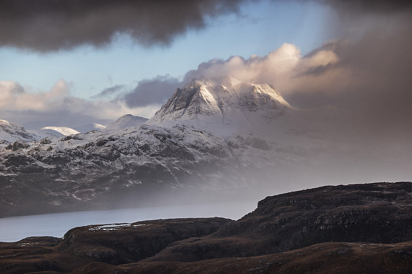Snow shower clearing Slioch, Wester Ross.