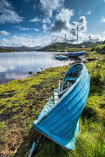 Beautiful blue rowing boat looking very vibrant in morning light at Badachro, We