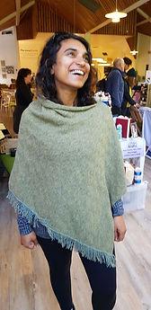 Real customer wearing Seashore textures poncho. Knitted with merino wool by Elizabeth Larsen Knitwear. Knitwear made in Scotland.