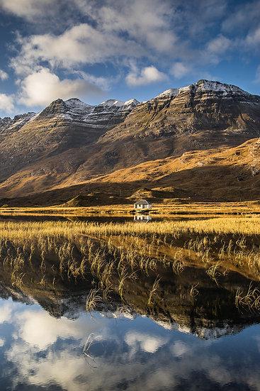 An autumnal Liathach reflecting into Lochan an Lasgair, Glen Torridon.