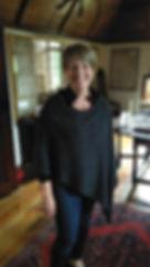 Real customer wearingHighland Poncho knitted by Elizabeth Larsen Knitwear. Knitwear made in Scotland.
