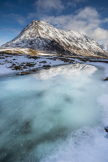 Frozen burn with aqua ice leading towards Beinn Dearg. Torridon.
