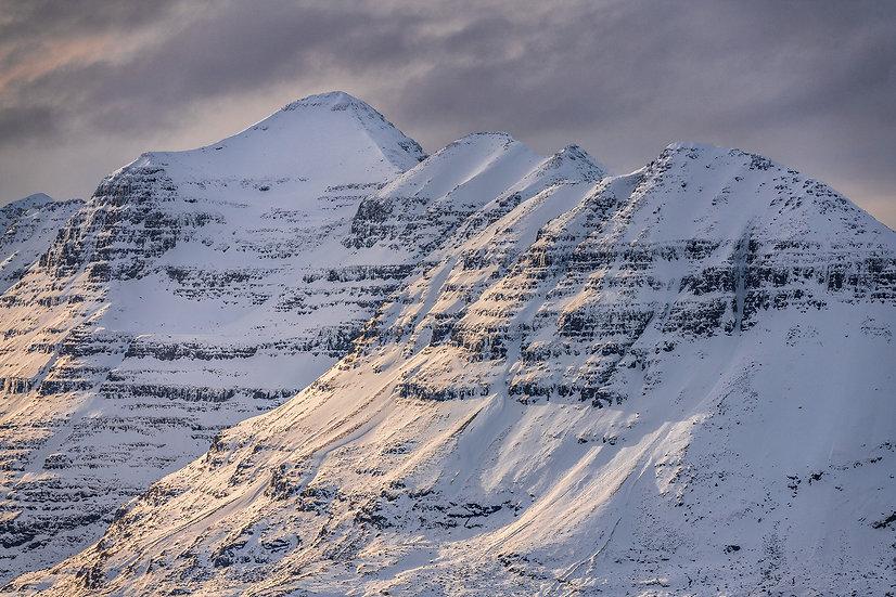 Climbers climbing the ridge to Spidean a Choire Leith, Liathach.