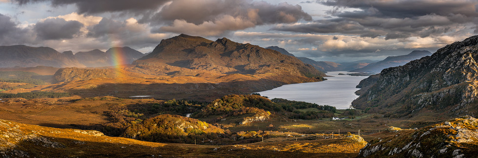 Looking down Loch Maree towards Glen Docherty with a slight rainbow over the Fishfield mountains and Beinn Airigh Charr.