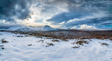 Interesting clouds above the snow capped Coulin Estate and Torridon mountains.