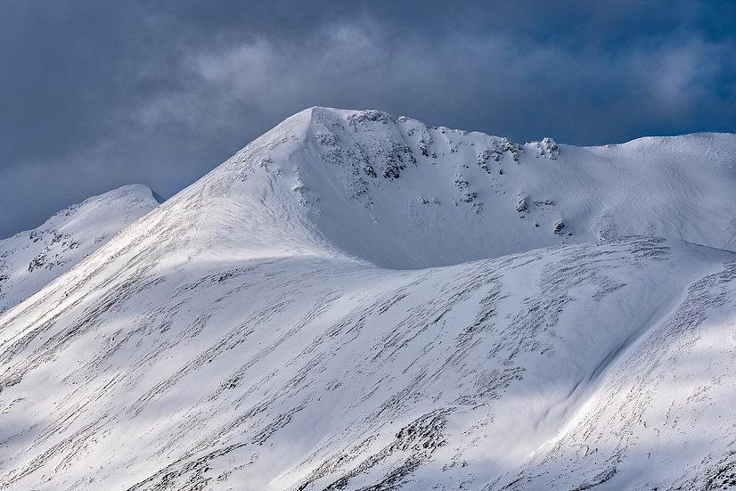 Dark skies above snow covered Sgurr nan Fhir Duibhe, Beinn Eighe, Torridon