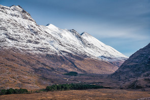 Road leading towards Kinlochewe, Glen Torridon with Liathach and Beinn Eighe towering above it.