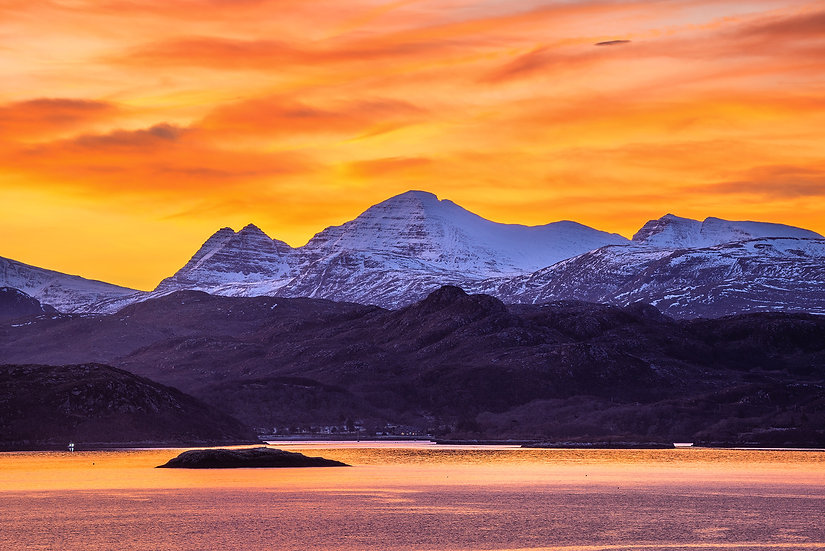 Sky on fire sunrise above Beinn Alligin, looking across Loch Gairloch