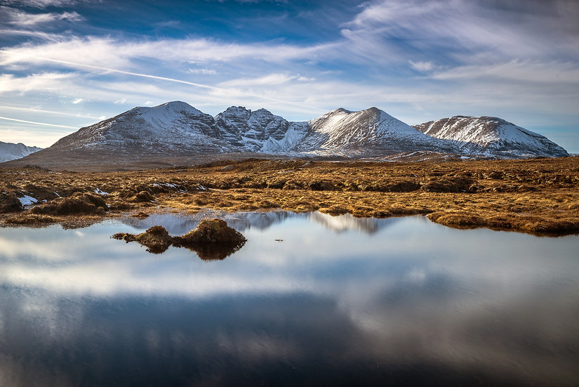 Looking across a small Lochan to An Teallach.