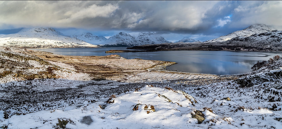 A wintry Torridon with clouds clearing the mountains.