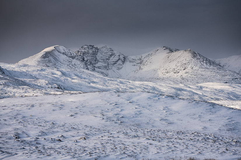 Moody skies above a snow covered An Teallach.