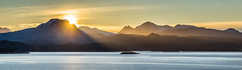 Sun rising behind Baosbheinn lighting up Beinn Alligin, Torridon
