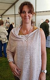 Asymmetric poncho pastel pink. Summer Poncho, off th shoulderasymmetric top, knitwear madein Scotland by Eliabet Larsen Knitwear