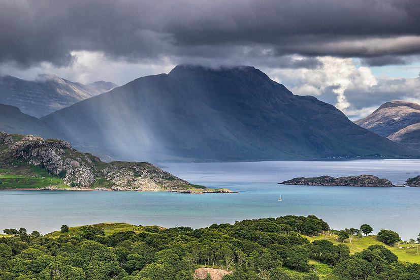 Yacht sailing down Upper Loch Torridon with a rain shower passing over Liathach