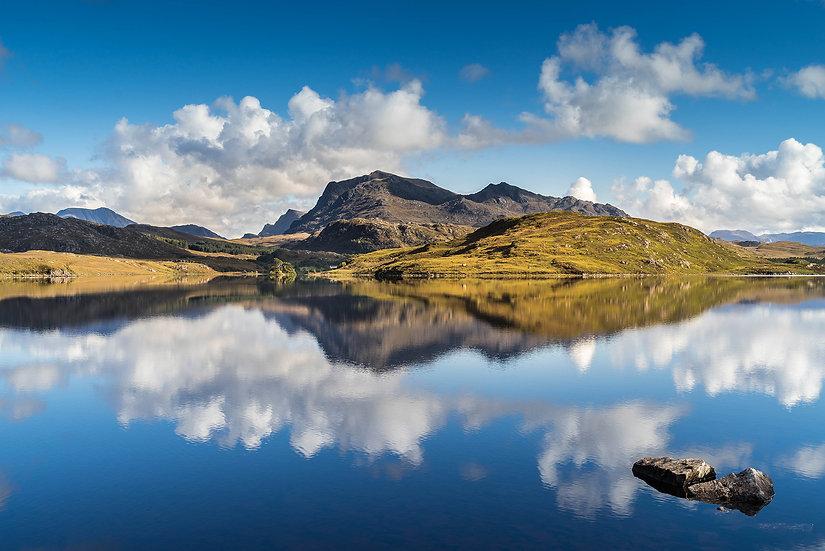 Beinn Airigh Charr reflecting in clam Loch Kernsary.