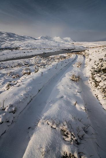 Snow on the Fain with An Teallach in the distance.