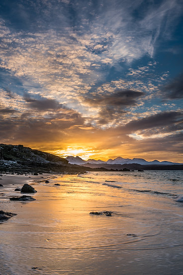 Sunrise over the Torridon mountains from Big Sand, Gairloch.