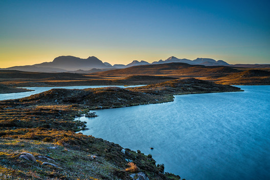 Early morning light catching the Torridon mountains, Wester Ross.