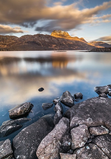Calm Loch Maree with Slioch towering in the background.