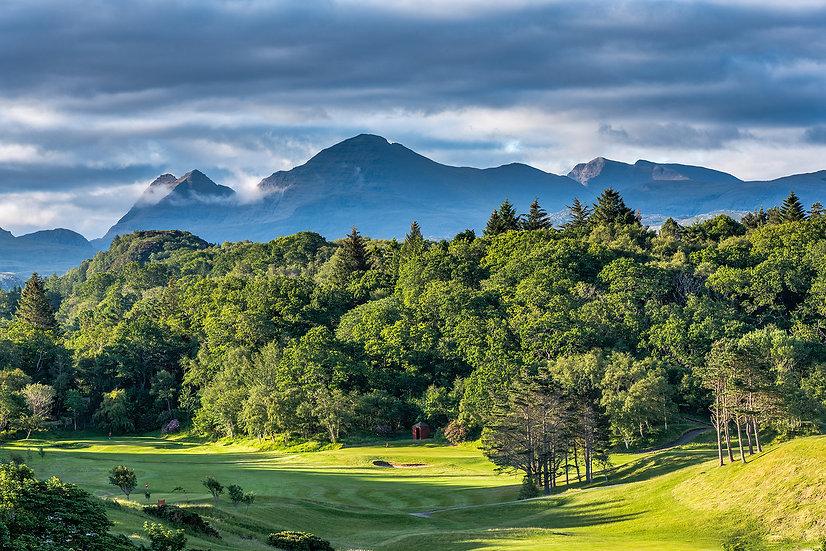 A very green Gairloch golf course with Beinn Alligin in the background