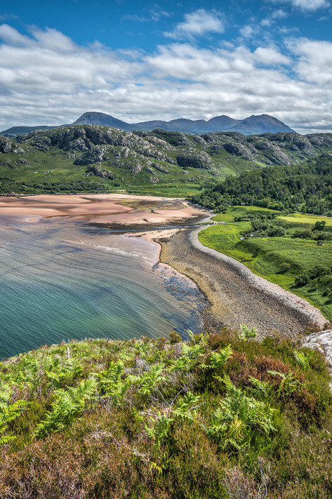 Gruinard Bay looking very green on a perfect summers day.