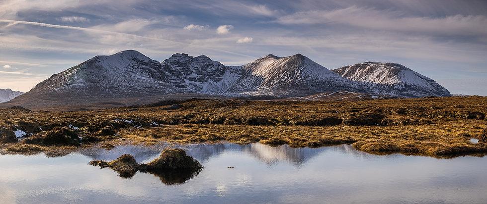 An Teallach reflecting in a small Lochan