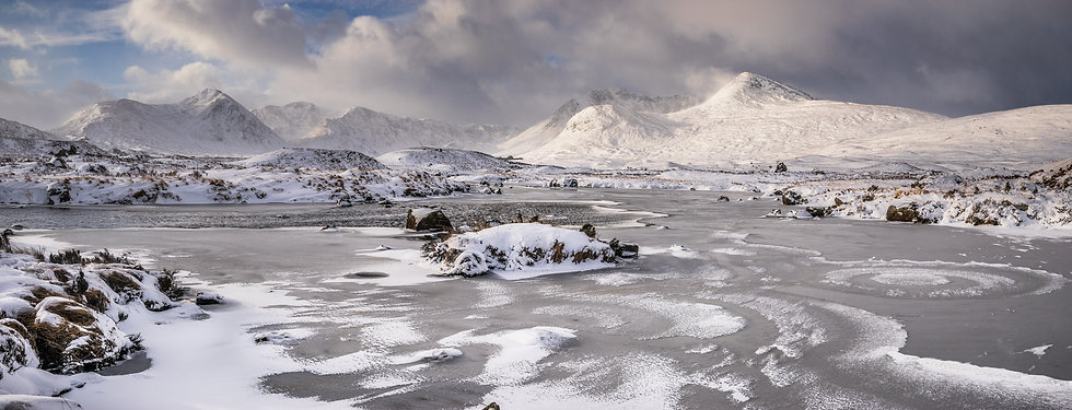 Frozen Loch and snow covered Black Mount mountains.