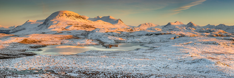 Late afternoon sunlight on Sail Mor, An Teallach and the Fisherfield mountains