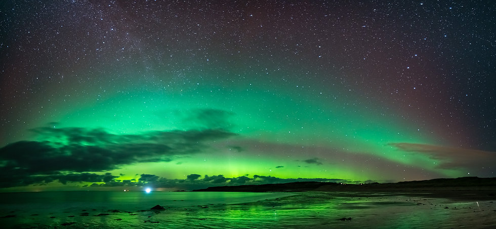 Northern Lights (Aurora Borealis) over the Minch from Opinan beach Wester Ross.