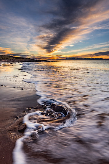Sun setting over Skye with the tide coming in on Opinan Beach