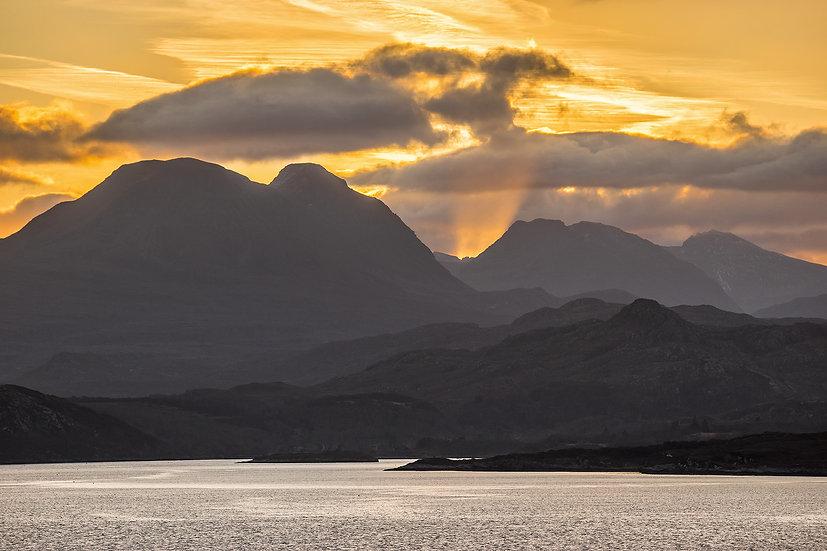 Sun rising behind Baosbheinn, Beinn Dearg and Liathach