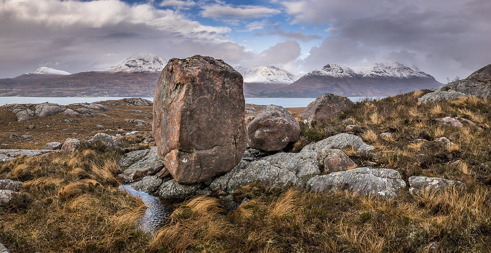 Tortoise looking rock with the Torridon mountains in the distance